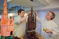 Christian Escriba and his son making a `Mona´, typical chocolate cake of Pascua´s monday, the godfather gives his godson, catalan tradition, Escriba  ...
