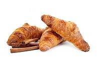 Croissants and stiks cinnamon isolated on white background