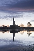 Salisbury cathedral at dawn reflecting in the flooded West Harnham Water Meadows, Salisbury, Wiltshire, England, United Kingdom, Europe