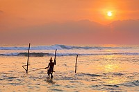 Sri Lanka - fisherman catches fish at sunset time, Koggala Beach, south part of Sri Lanka, Indian Ocean coast, Asia