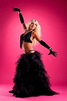 athletic blond woman posing in east style costume