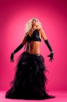 blond woman dance in black oriental costume