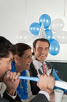 Office celebration, mature man looking at camera