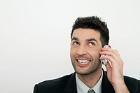 Mid-adult businessman talking on cell phone