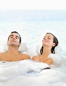 Couple relaxing in bathtub