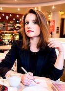 woman is flirting in modern cafe