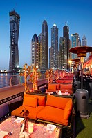 Dubai Marina by night, restaurant on the promenade in Marina district, Dubai, United Arab Emirates