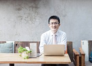Businessman using laptop in a restaurant