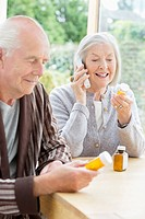 Older couple taking medication
