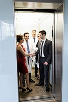 Doctors and business people in elevator