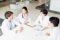 Doctors talking in meeting