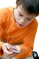 Boy listening to music on an iPod MP3 player.