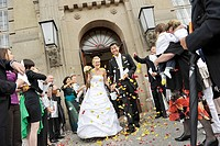 Newly married couple coming out of the registry office, bridal couple, wedding, bride, groom, civil registry office, Schoeneberg town hall, Berlin, Ge...