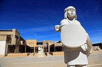 The statue of an Acoma Pueblo tribe warrior in front of the Sky City Cultural Center of Acoma Pueblo. Acoma Pueblo. New Mexico. USA