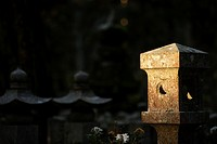 Morning light on a lantern at Okunoin graveyard. Koyasan, Japan
