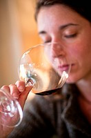 Woman Sniffing Glass of Red Wine