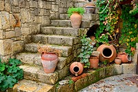 Terracotta flowerpots on an outdoor stone staircase in hillside town of Yesilurt Malatya Turkey