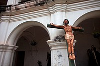An sculpture of a crucified Thief sits inside the Escuela de Cristo during preparations of an Easter Holy Week procession in Antigua Guatemala, Guatem...