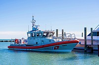 USA, Texas, Coast guard vessel docked at marina in Rockport Fulton