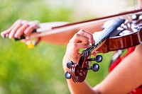 USA, Texas, Young woman playing violin, close up
