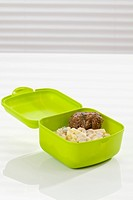 Potato salad with meatball in lunch box, close up