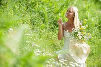 Austria, Altenmarkt-Zauchensee, Mid adult woman picking flowers