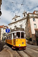 typical yellow tram in high town in lisbon. portugal