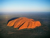 Australia, Northern Territory, Uluru-Kata Tjuta National Park, aerial view of Ayers Rock, the famous inselberg is a large arcose outcrop rising 348 me...