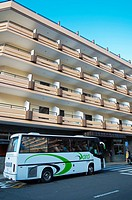 Bus transporting tourists in front of a hotel along Calle Cupido street Puerto de la Cruz city Tenerife island the Canary Islands Spain Europe