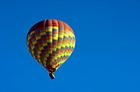 Hot air balloon in the blue sky, Göreme, Cappadocia, Nevsehir Province, Central Anatolia Region, Turkey