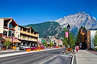 view through the main street in front of a picturesque mountain range with the Cascade Mountain, Canada, Alberta, Banff National Park, Banff