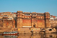 India, Uttar Pradesh, taken from a boat on the Ganges; Varanasi, Bonsale Ghat with blue &amp; red wooden boat