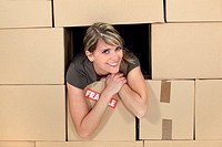 woman in a house made of carton