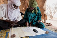 Niger, Sahara Desert, Escarpment Of Tiguidit; Agadez Region, Tuareg Men Checking Route's Gps Points
