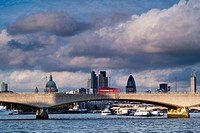 England, Greater London, London South Bank / River Thames. Waterloo Bridge, St Pauls Cathedral, the Gherkin and the financial city of london in the di...