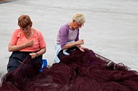 Two Senior Women Repairing Fishing Net, Euzkadi, Gipuzkoa, Spain, Europe