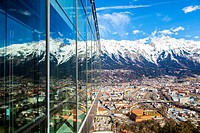 View from Bergisel Schanze ski-jump down onto the stadium, city of Innsbruck and Nordette mountain. Tyrol, Austria, Europe