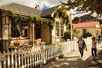 Arrowtown main street, historic Postmaster's residence, goldfields town now tourist resort, autumn, Otago, New Zealand,