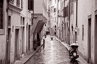 Raining in Street in Florence, Italy in Black and White Sepia Tone