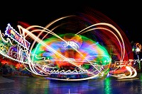 Dynamic light traces of an carousel, Hamburger DOM fairground, Germany
