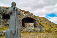 Statue of St. Patrick, Ireland's patron saint, and an Altar, at Maumeen pass, Maamturk Mountains, County Galway, Ireland. Every year pilgrims climb to...