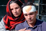 A Mother Stands With His Injured Son after He Was Injured In Earthquakes In Tangdhar Kashmir , Jammu and Kashmir , India On 08 Oct,2005