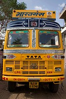 Trucks ; Tata LPG van ; transportation ; yellow color of the front of the truck; Jaipur ; Rajasthan ; India