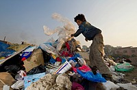 One of the children who live, play and work on the garbage dump at Bhagmati River in the middle of the city