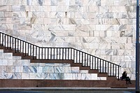 Arengario stairs with woman (waiting for elevetor) - Milan, Italy.