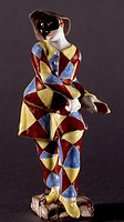 Harlequin, character from Commedia dell'Arte, polychrome porcelain, height 12 cm, Doccia manufacture, Sesto Fiorentino, Tuscany. Italy, 18th century. ...