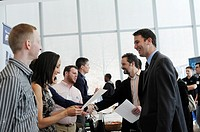 Job seekers attend the Fourth Annual NYC Startup Job Fair in New York. The Labor Department reported a rise in unemployment benefit applications for l...