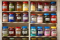 Shelf full of jars of dye colors