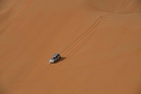 Four wheel drive going down steep sand dune; Liwa, Abu Dhabi, UAE