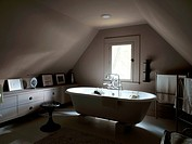 Freestanding bathtub in attic bathroom in USA home